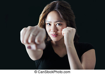 Self defense girl - Young woman practicing self defense...