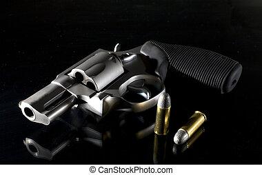 Self defense handgun - Revolver that is on a black...