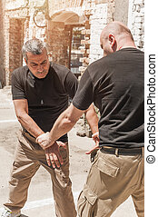 Self defense techniques against a knife attack - Kapap...