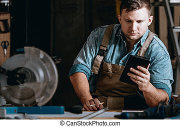Self-employed machine constructor calculating costs while...