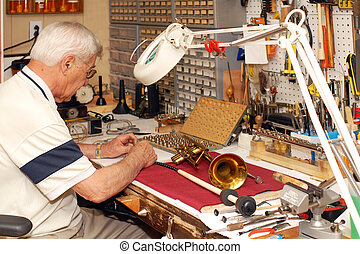 Self-Employed Senior - A senior man repairing broken musical...