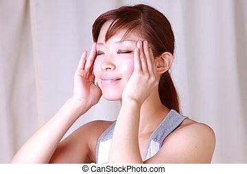 self head massage - young Japanese woman doing self head...