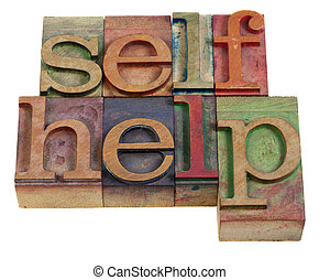 self-help words in vintage wooden letterpress printing blocks