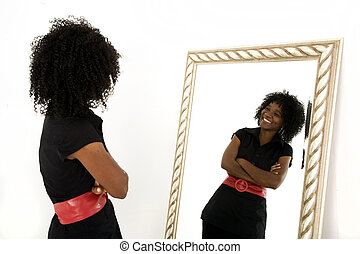 Self Image - Lady looking at herself in mirror smiling