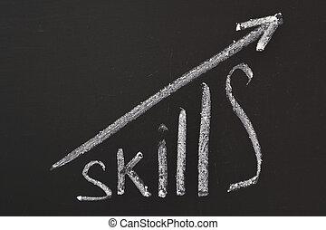 self improvement - word Skills hand written on the...
