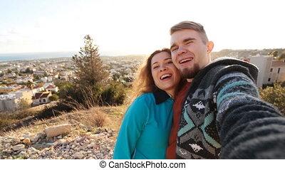 Self portrait, happy couple traveling