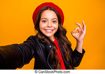 Self-portrait of her she nice attractive lovely pretty charming fashionable cheerful cheery glad long-haired girl showing ok-sign isolated over bright vivid shine vibrant yellow color background