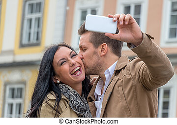 selfie a couple - a young couple making a self-portrait with...