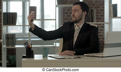 Selfie businessman taking pictures in the office