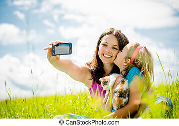 Selfie - mother, child and kitten