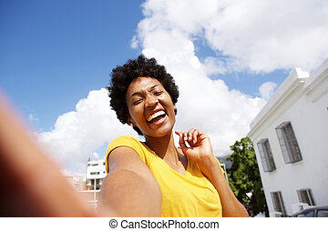 Selfie of a cheerful young african woman
