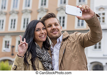 selfie of a couple - a young couple is taking a self...