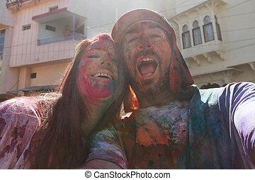 Selfie of couple at holi festival