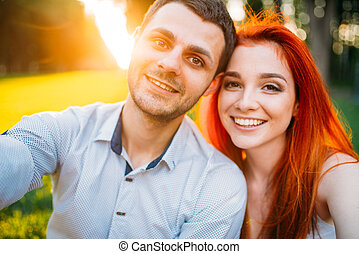 Selfie of love couple on sunset, romantic date