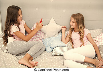 selfie of modeling of kids - two little girls making selfie on smartphone. little girls kids modeling in bedroom. confident in her style.