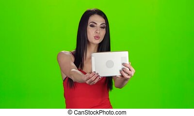 Selfie photo using the front camera of tablet. Green screen