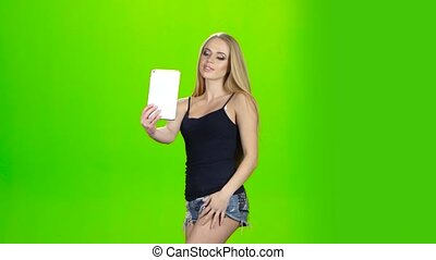 Selfie. Photo using the front camera of tablet. Green screen