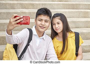 Selfie-portrait of funny couple outdoor
