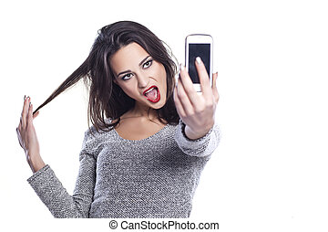 selfie - pretty girl take a self portrait with her smart...