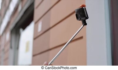 Selfie stick with mobile phone shot