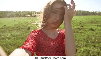 Selfie. The girl makes selfie, takes pictures of herself in...