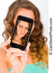 Selfies Everywhere - Gorgeous woman smiling kindly taking a ...