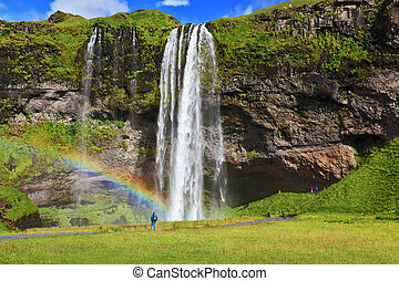 Large rainbow decorates a drop of water