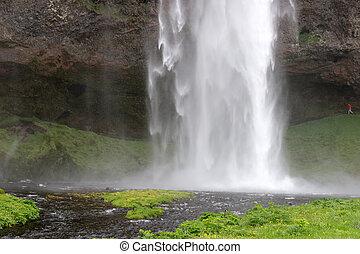 Seljalandsfoss waterfall. Tourist attraction of Iceland -...