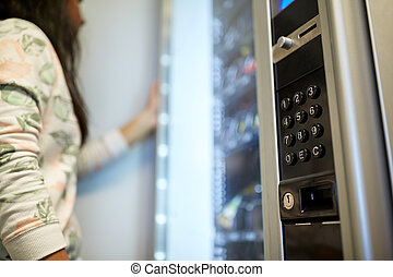 woman at vending machine - sell, technology and consumption...