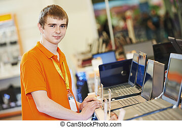 Seller at computer store - Happy seller assistant man in ...