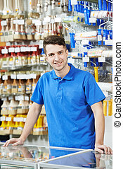 Seller at home improvement store - Happy seller assistant ...