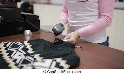 Seller checks the price at the cash register