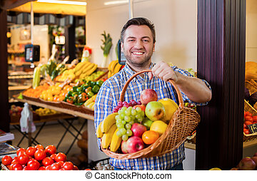 Seller suggests to buy ripe fruits. - Happy seller suggests...