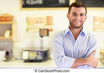 Seller - Young man in a store