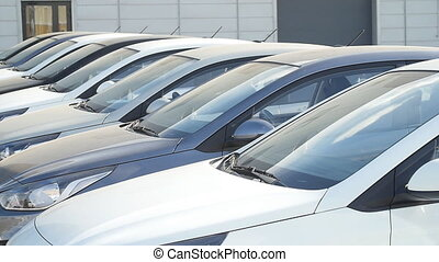 Selling and renting cars concept. Row of cars - selling and...