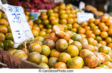 selling Asian oranges in the fruit markets.