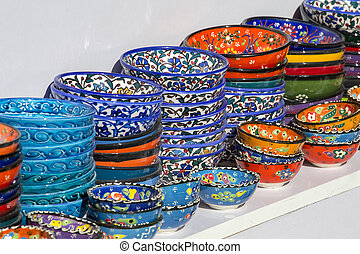Selling colorful bowls in the shop of traditional Arabian market at Souq Waqif market in Doha, Qatar