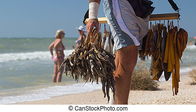 selling dried fish at the beach - Funny original merchants...