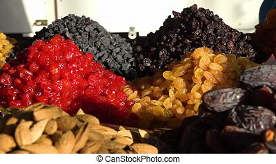 Selling dried fruits and nuts on a market - A close up shot...