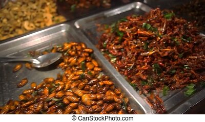 Selling fried insects at the night market in Koh Samui Thailand
