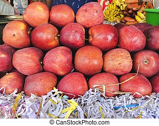 Selling Juicy fresh Red Apple, closeup. Wholesale market. Red Apple in a box. Selling crops on the market. Natural, healthy, vitamin-rich foods. Food for health. High Vitamin-A