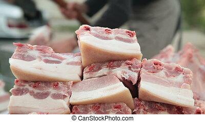 Selling pork meat at street market