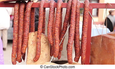Selling smoked meat on stall, street market. - Cured meat...