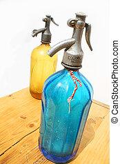 Seltzer bottles - Two antique seltzer bottles on weathered...