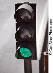 Semaphore in the street. Green color on