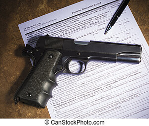 Semi auto handgun and purchase paperwork - Handgun and pen...