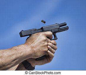 Semi auto handgun - Empty brass flying from a semi auto...
