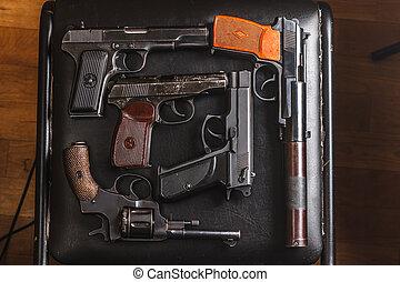 semi-automatic pistols on pixel camouflage background -...