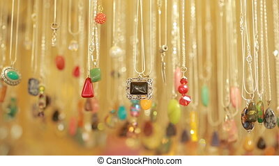 Semi precious jewelry stones beads in shop sale. necklace on...