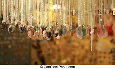 Semi precious jewelry stones beads in shop sale. necklace on the counter